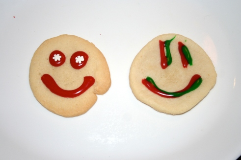 Holiday cookies. Aunt Smiley on the left; Uncle Smiley on the right.